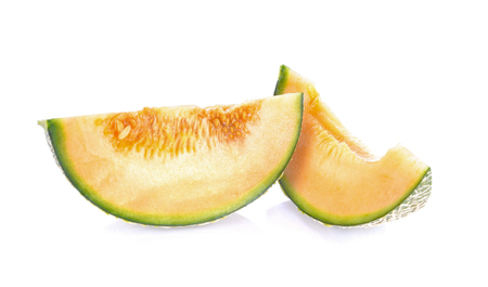 Melon pieces on white background Imagens