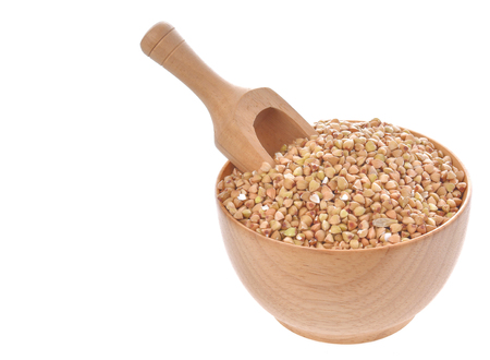 Buckwheat isolated in wood bowl on white background