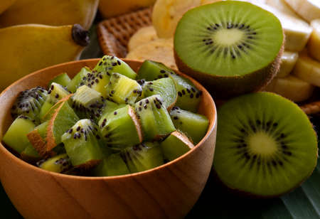 Kiwi in a wooden bowl
