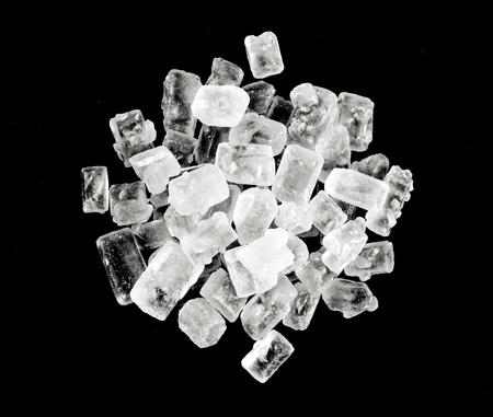 Rock sugar on black Stock Photo