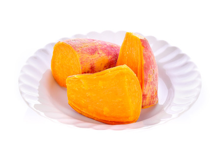 yam: Sweet potatoes on a plate on white background Stock Photo