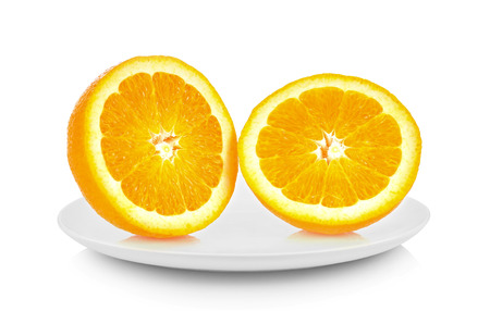 Orange piece in white plate on white background