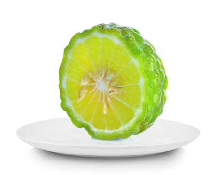 Piece Kaffir lime in white plate on white background