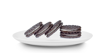 sandwich cookies with cream in white plate on white background Stock Photo