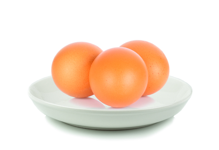 Eggs in white plate on white background
