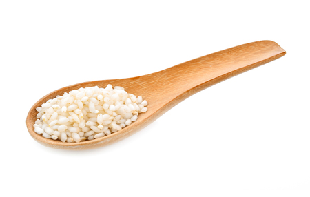 rice seeds In wooden spoon on white background Imagens