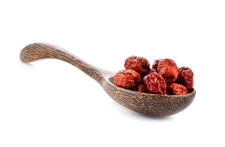 Chinese jujube isolated In wooden spoon on white background Imagens