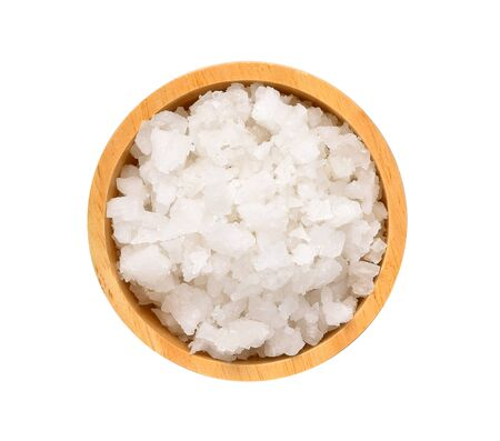 Salt in wood bowl on white background