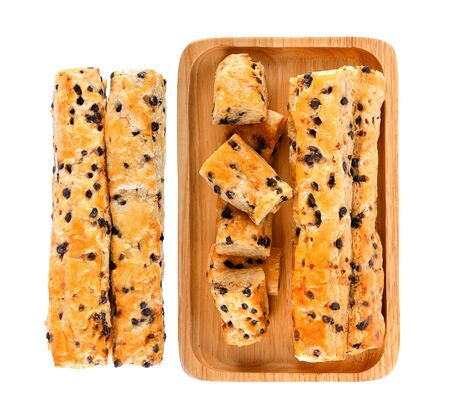 Chocolate chip stick In a wooden plate on white background