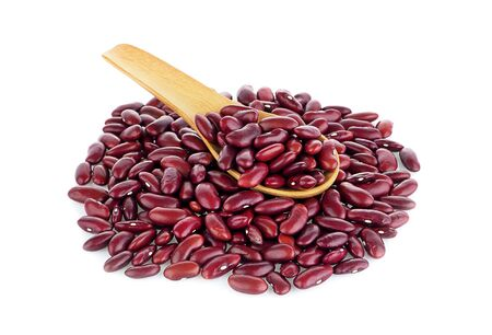 Red beans in wood spoon on white background