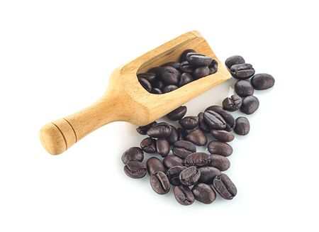 Coffee beans in wood scoop on white background