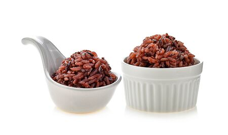 brown rice in white bowl on white background