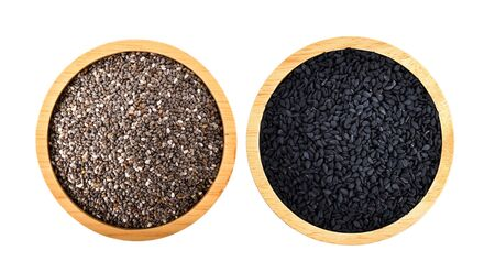 chia seeds and sesame seed isolated in wood bowl on white background