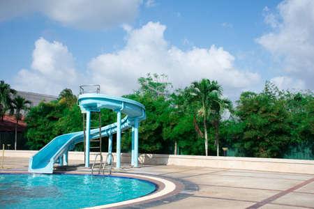 Blue slide for children in the pool