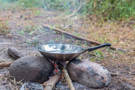 soup kettle: Cooking in field conditions, boiling pan at the campfire on picnic Stock Photo