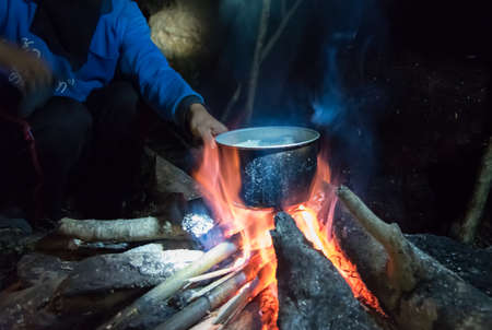 boiling pot: Cooking in field conditions, boiling pot at the campfire on picnic