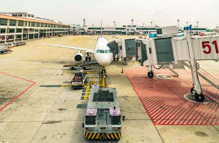 may fly: DONMUANG INTERNATIONAL AIRPORT, BANGKOK,THAILAND - MAY 30, 2016: Thai Smile Airways flight WE-283 load passengers and luggage before fly from Donmuang Interational Airport to Phuket Interational Airport.