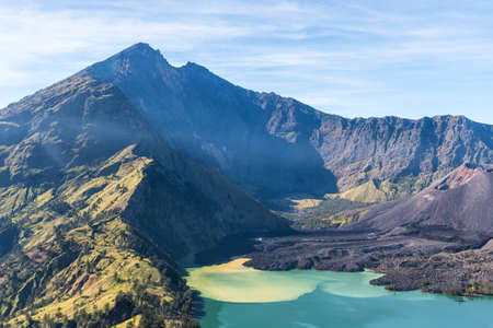 landscape of active volcano Baru Jari, Lake Segara Anak and summit of Rinjani mountain. Lombok island, Indonesia.