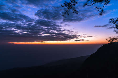 Colorful sky and mountains before sunrise at Phukradueng National Park, Thailand. Stock Photo