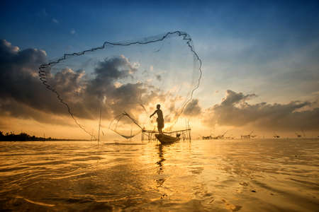 engeneering: Silhouette of fish lift nets in morning at Pakpra, Phatthalung, Thailand
