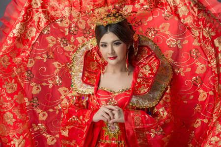 qipao: Beautiful Asian model Young asia Oriental woman wearing chinese qipao dress - studio shot Stock Photo