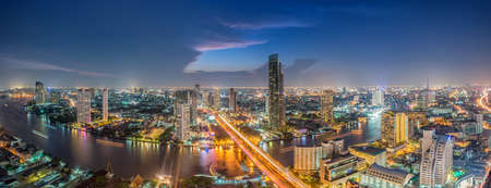 Bangkok Transportation at Dusk with Modern Business Building along the river (Thailand)-Panorama 스톡 콘텐츠