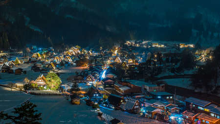 lightup: The Historic Villages of Shirakawago are one of Japans UNESCO World Heritage Sites.Shirakawago light-up with Snowfall Gifu Chubu Japan Stock Photo