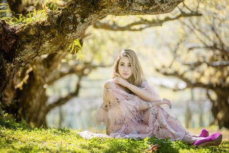 Portrait of a Beautiful Asian fashion woman  wear traditional, enjoying beauty in a flowering spring garden