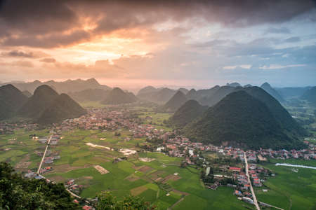 yuan yang: Rice field in valley around with mountain panorama view in Bac Son valley, Lang Son, Vietnam Stock Photo