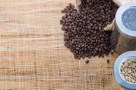 Cup of coffee on coffee beans background on a wooden table Reklamní fotografie