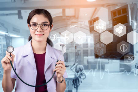 Doctor with a stethoscope in the hands and Operating room background, Modern medical technology and innovation concept 版權商用圖片