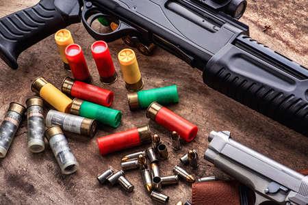 Weapons and military equipment. 9 mm pistol gun bullets and 12 gauge shotgun
