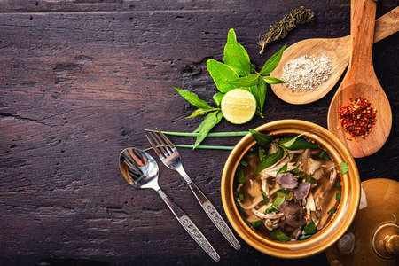 Hot vegetable soup with chicken, puree, herbs, pumpkin,cannabis, seeds for lunch fillet in a bowl over dark rustic wooden background Top view 版權商用圖片