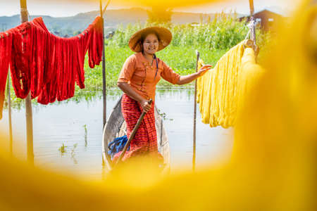 Burmese dry thread the Handmade colourful lotus fabrics at Inle Lake, Shan State in Myanmar.