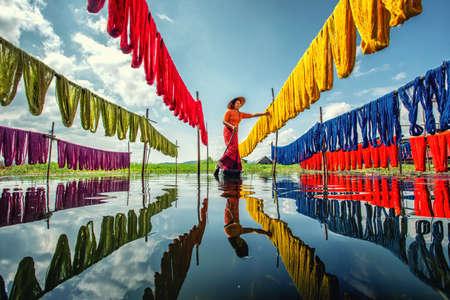 Burmese dry thread the Handmade colourful lotus fabricsat Inle Lake, Shan State in Myanmar. - vintage film grain filter effect styles
