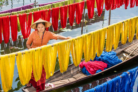 Burmese dry thread the Handmade colourful lotus fabricsat Inle Lake, Shan State in Myanmar. 스톡 콘텐츠