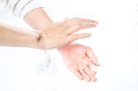 Coronavirus Covid-19. Cleaning Washing Handsspraying alcohol gel or antibacterial soap sanitizer. 스톡 콘텐츠