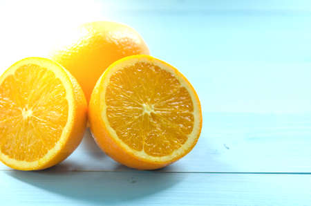 Fresh oranges on light blue wooden background. Selective focus. Health  and nature food concept.