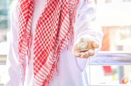 Stopwatch on hand of Arab man, give time or chance concept. Standard-Bild
