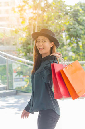 Beautiful woman with a lot of shopping bags,waling with smiling ,Lovely Activity Happiness Lifestyle.Friendship Leisure Casual Commercial Shopping Purchase Concept