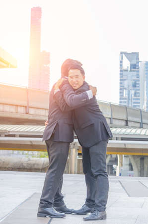Two  businessmen Greet with a hug in the city background,close upnconcept,copy space.