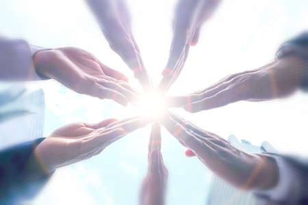 Seven hands together as pizza,cooperation,teamwork concept.