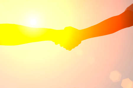african american handshake: Hand shake with sun set background,silhouette,corporate concept.