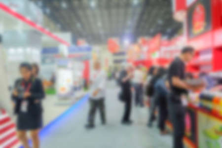Abstract Blur image of Exhibition Hall and people for background usage .