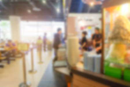 Abstract blur image of food court on day time for background usage.