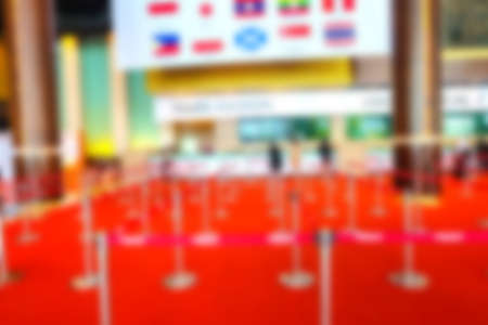 Blurred image of  register counter and row at the exhibition hall for background usage. Stock Photo