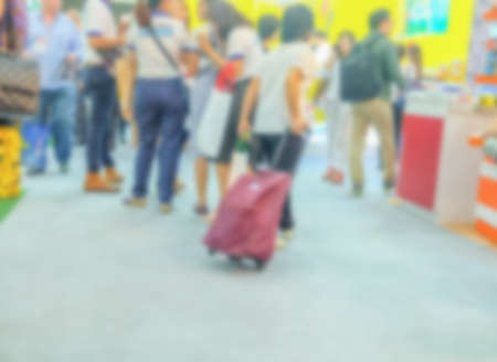 Abstract Blur image of Exhibition Hall and people talking for background usage .