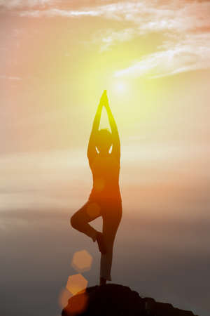Asian woman standing meditatiion pose outdoor,silhouette,outdoor,copy space,relax concept.