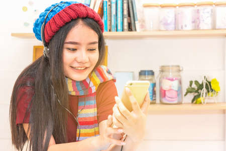 Beautiful Asian woman looking at smart phone,selective focus,lifestyle concept.