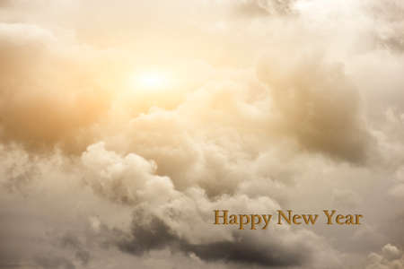 cloudy sky with Happy new year text